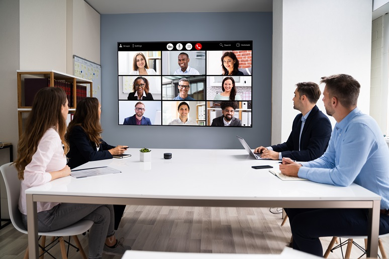 Hybrid work, with video meeting participants in office at at home