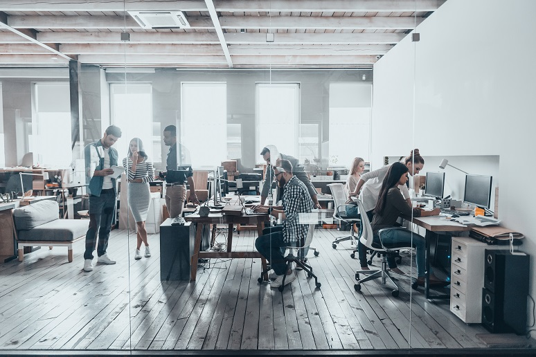 Picture of team members working together in open office