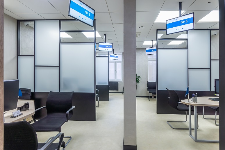 Photo of modern office with digital signage