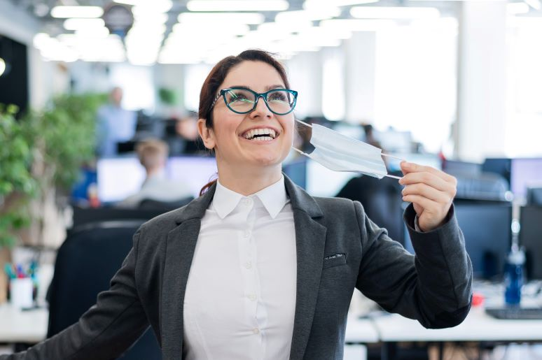 Businesswoman happy to be returning to office
