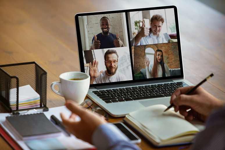 Remote worker meeting with colleagues via video