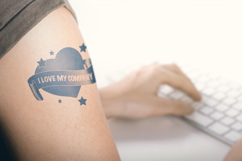 "Photo of employee with ""I love my company"" tattoo"