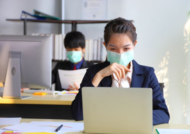 Photo of office workers with face masks