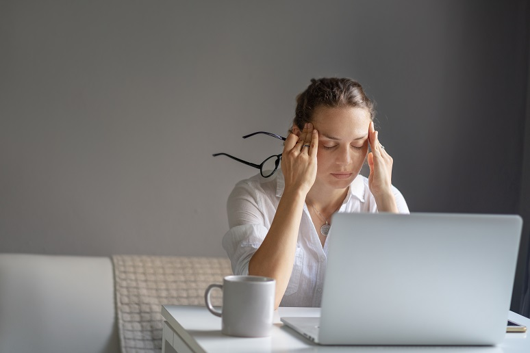 A woman experiencing work burnout