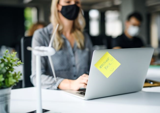 Young female professional wearing mask in the office