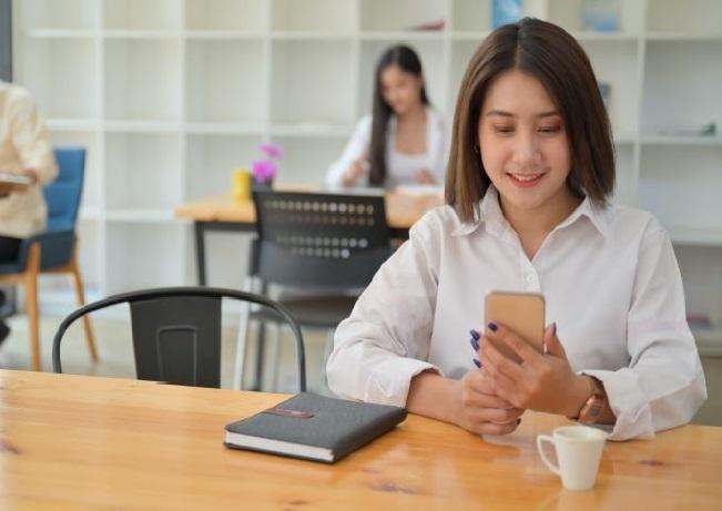 Woman at work social distancing