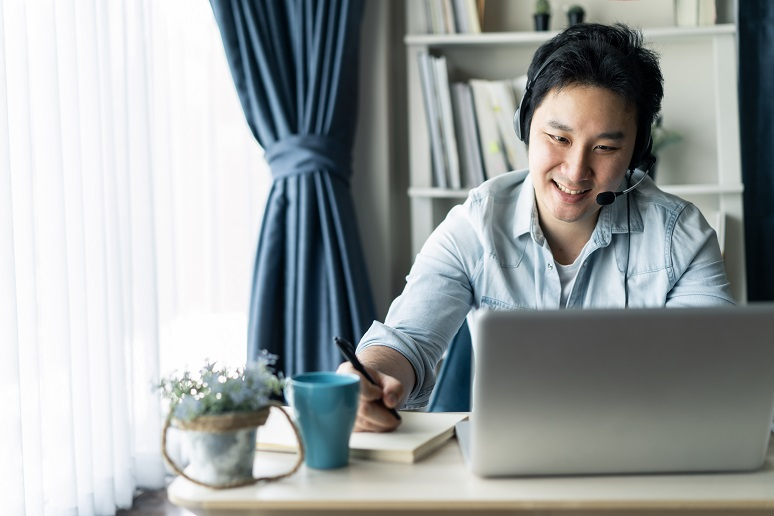 A happy employee working from home