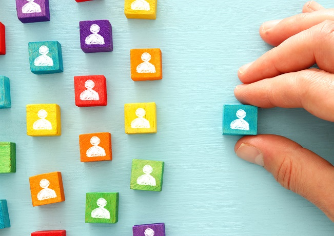 image of colorful blocks with people icons to show human resources and management concept