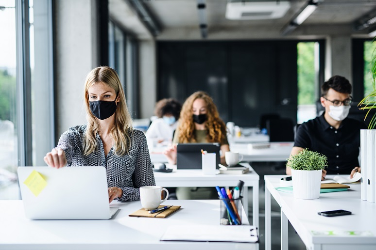 Workers wearing masks working in an office