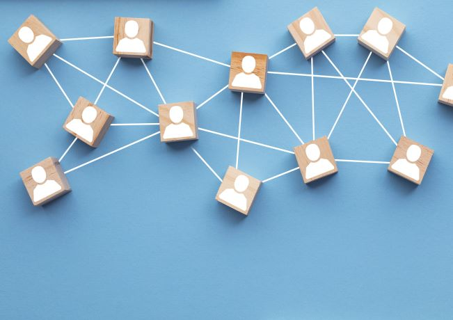 illustration of ooden blocks connected together to show teamwork