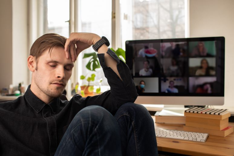 Man showing fatique from too many video meetings
