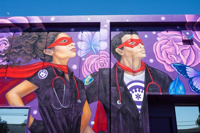 A mural showing EMTs at heros; Royal Ambulance station