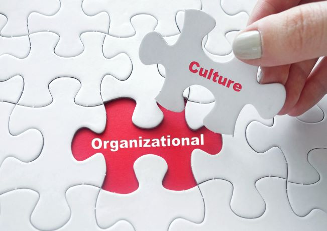Illustration of putting together organizational culture puzzle pieces