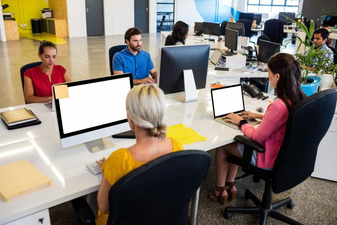 Photo of open office environment with workers