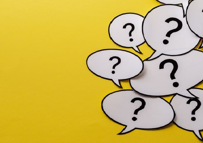 Photo illustration of a bunch of question marks