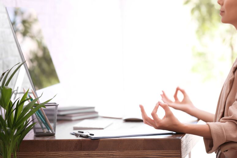 Women being zen at her desktop