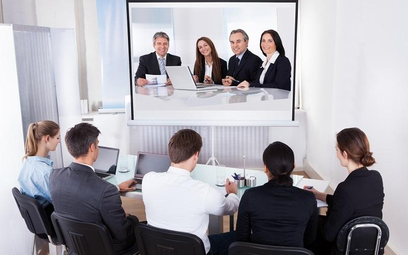 People working in a huddle room